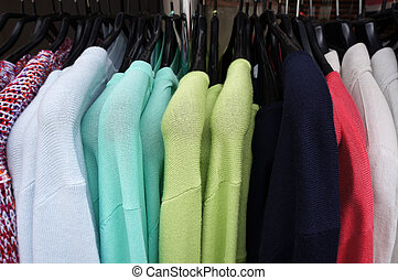 Pullovers on hangers. - Colorl pullovers on hangers.