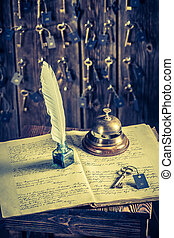 Old reception in hotel with guestbook and keys for rooms