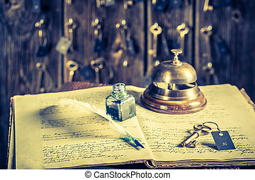 Guestbook and keys for rooms in vintage front desk in hotel