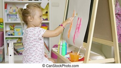 Cute little blond girl painting with watercolors - Cute...