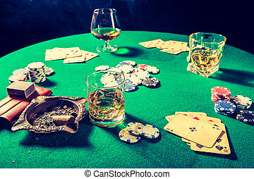 Closeup of gambling table with chips and cards