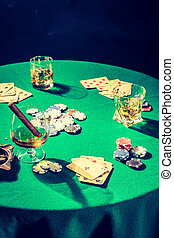 Table for poker with chips and cards