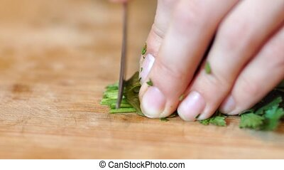 chopped vegetables close-up - women's hands cut a knife a...