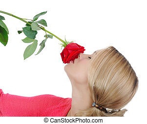Pretty girl sniffing a red rose Isolated on white background...