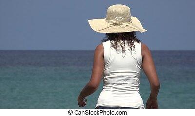 Woman Wearing Hat Staring At Ocean