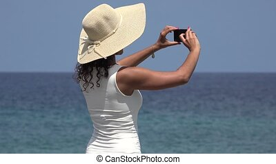 Tourist Taking Photo Of Ocean