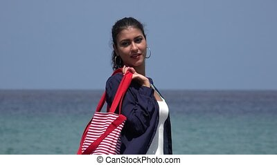 Tourist Woman Posing At Ocean