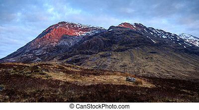 Glencoe, Scotland - with the sun setting behind me, the...