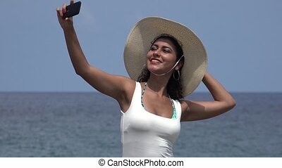 Female Taking Selfie At Ocean