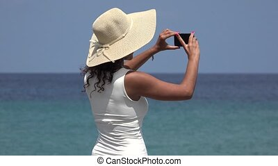 Teen Taking Photos During Spring Break