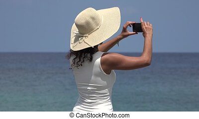 Girl Taking Photos On Spring Break