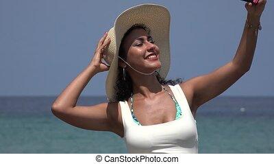 Beautiful Young Woman Wearing Hat Taking Selfies