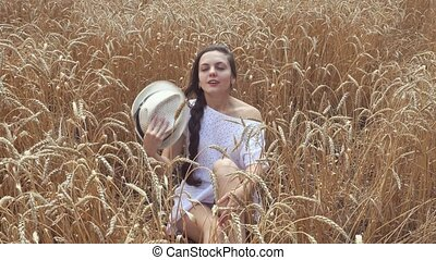 woman in white dress in wheat field - Young woman in white...