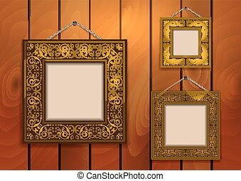 Frames on wooden background