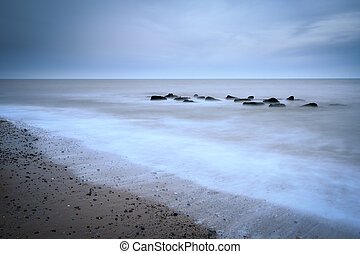 Tranquil waters - Long exposure shot on a beach, Tranquil...