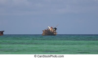 Old Shipwreck At Sea