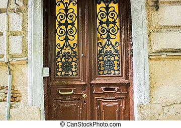 vintage wooden door with wrought iron bars - Beautiful...
