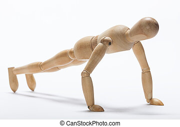 Push-up exercise - Wooden mannequin doing push-up exercise