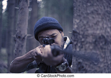 Interracial hunter in the forest
