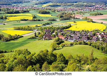 Rural landscape with a village in Franconia Germany