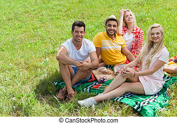 Friends picnic people group sitting blanket outdoor green...