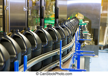 Packaging line - Empty containers are lined up on the...