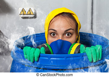 Woman in gas mask sitting in the barrel