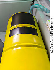 Big yellow barrel in chemical lab
