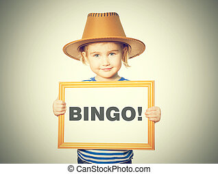 with blackboard. Text BINGO! - Little Funny girl in striped...