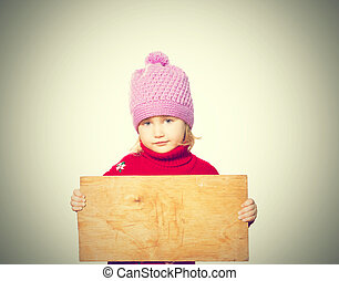 Little girl holding Board for text Isolated on white...