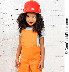 little girl in orange repairmen uniform
