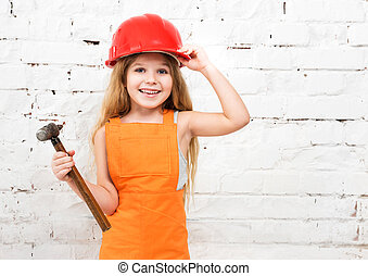 cute little girl in repairman uniform and hammer in hand