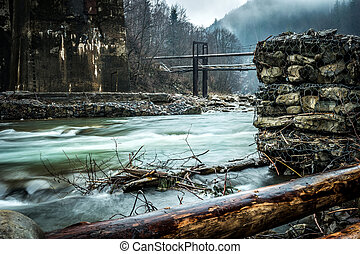 beautiful mountain landscape with lake and bridges in fog in...
