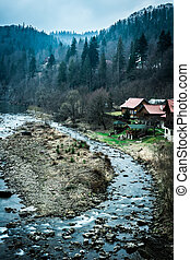 beautiful river with houses on bank in mountains - beautiful...