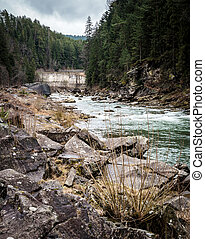 landscape in Carpathian mountains with river and railway...