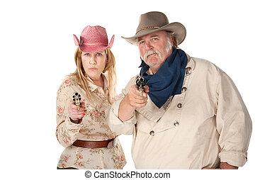 Western Wear Couple - Couple in western wear pointing...