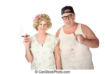 Cigar couple - Smirking homely couple with cigars on white...