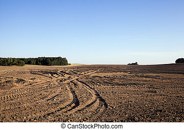 plowed agricultural field - agricultural field, plowed after...