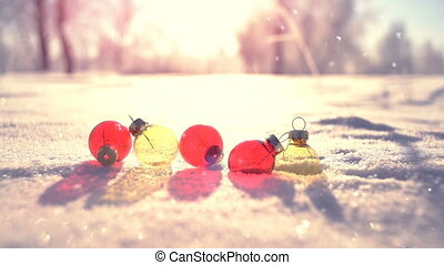 Christmas balls on snow in winter park slowmotion