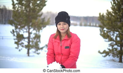 Young Thai Woman throwing up snow slowmotion