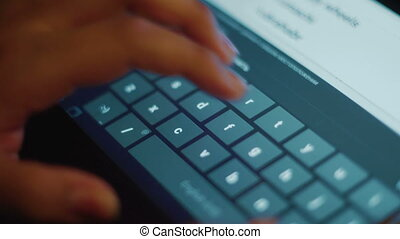 Female hands typing on tablet keyboard close-up - Female...