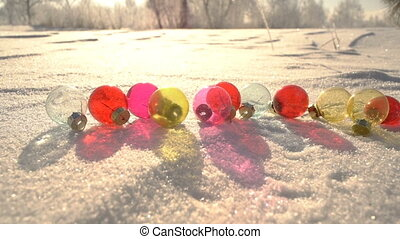 Transparent Christmas balls on snow drift slowmotion -...
