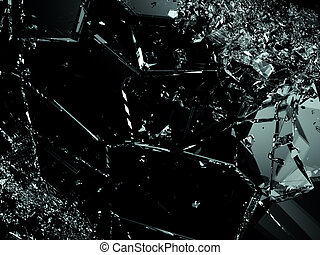 Pieces of splitted or cracked glass on black. Large...