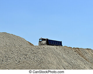 Truck on top of an earth mound