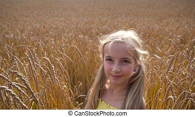 girl in wheat field - cute girl in wheat field