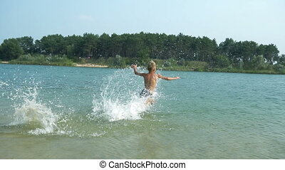 Boy makes a jump in the lake
