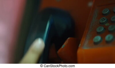Using phone booth close-up.