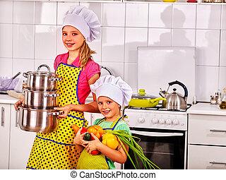 Children cooking at kitchen - Children wearing cooking hat...