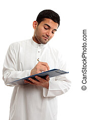 Ethnic businessman working - An ethnic businessman in...