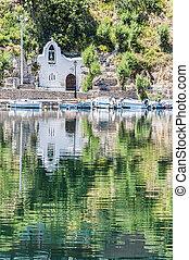 Agios Nikolaos Church - A church reflected in the water at...